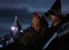 - I've got a plan how to get in there. - Fine. He's got a plan. - And you're gonna lead us. - Yeah! Me? - Yes, you. - I gotta get her out of there?! - That's right. - All right, I'll go in there for Dorothy. Wicked Witch or no Wicked Witch, guards or no guards, I'll tear them apart. I may not come out alive, but I'm going in there. There's only one thing I want you to do. - What's that? - Talk me out of it.